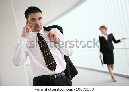 A handsome business man talking on cell phone - stock photo