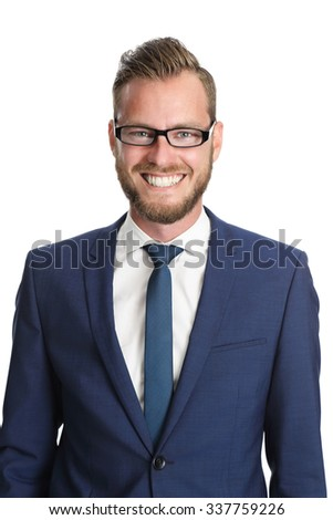 A handsome businessman in his 20s standing in front of a white background, wearing a blue suit and tie with glasses. Feeling confident and successful. - stock photo