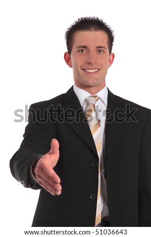 A handsome businessman reaches out his hand. All on white background.