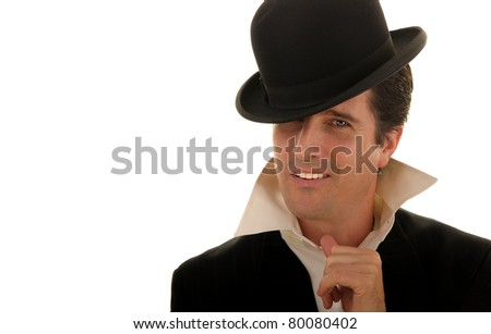 A handsome, cocky, confident man in casual clothing looks slyly at the camera. - stock photo