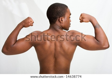 A handsome dark skinned guy showing his back and muscles in his biceps, isolated