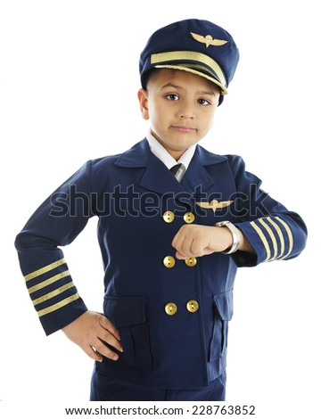"A handsome elementary ""airline pilot"" looking worried after checking his watch.  On a white background.  - stock photo"