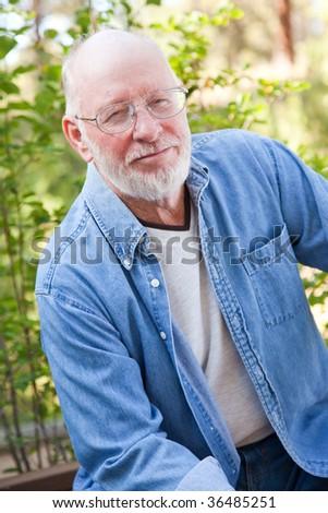 A Handsome Happy Senior Man Outdoor Portrait. - stock photo