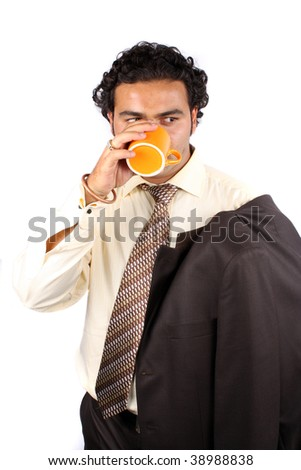 A handsome Indian businessman drinking coffee during a break, on white studio background. - stock photo
