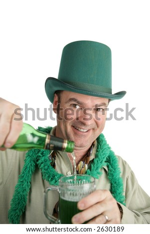 A handsome Irish American man pouring himself a green beer on St. Patrick's Day.