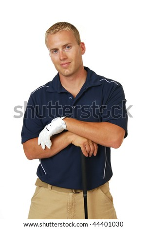 A handsome male golfer with his hands on his club - stock photo