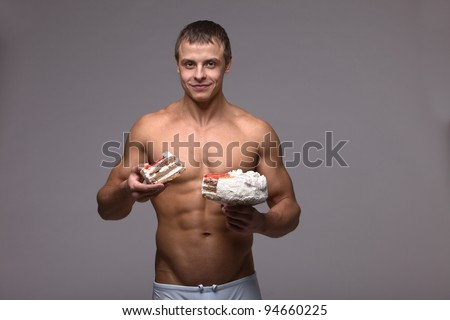 a handsome man and an athlete with a cake - stock photo