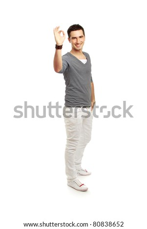 A handsome man shows a sign okay isolated on white background - stock photo