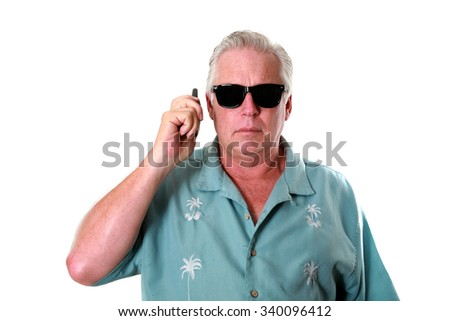 A handsome man uses a walkie talkie to communicate with someone. isolated on white with room for your text - stock photo