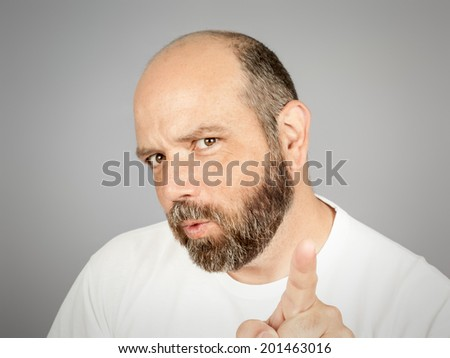 A handsome man with a beard is pointing to you - stock photo