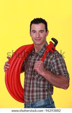 A handsome plumber. - stock photo