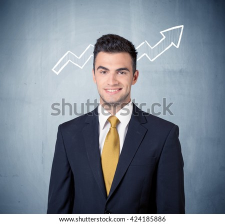 A handsome sales guy standing in front of a blue urban concrete wall with illustration of white graph chart arrows cocncept - stock photo