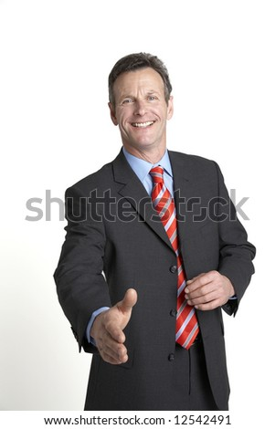 A handsome senior businessman offers his hand to shake - stock photo