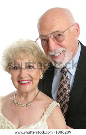 A handsome senior citizen couple dressed up for a night out. - stock photo