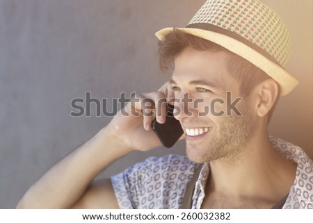 a Handsome trendy cool guy on vacation - stock photo