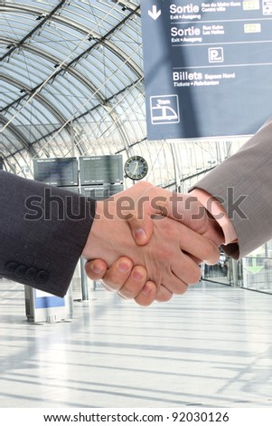 A handsome young business man hand shake at office building - stock photo