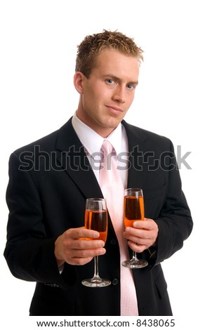 A handsome young man holding glasses of wine - stock photo