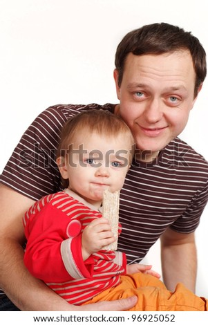 A handsome young man holding his son in his arms