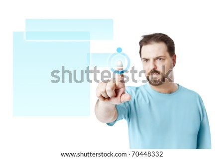 A handsome young man touching a virtual screen - stock photo