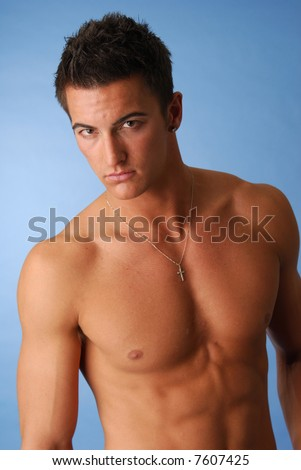 A handsome young man with no clothes on - stock photo