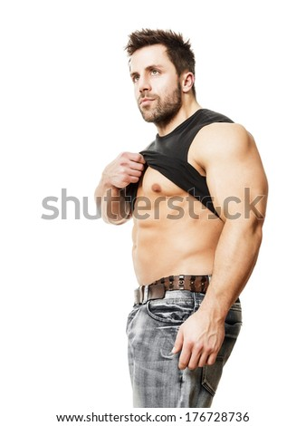 A handsome young muscular sports man his black shirt - stock photo