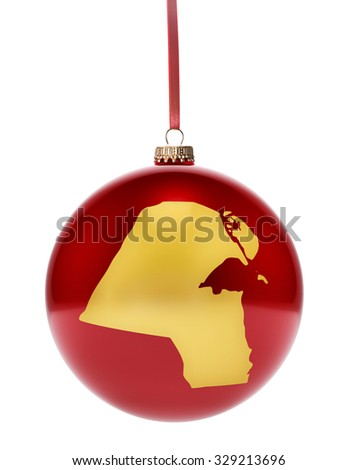 A hanging glossy red bauble with the golden shape of Kuwait.(series) - stock photo