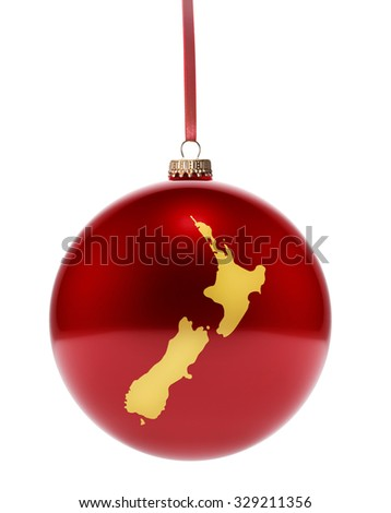 A hanging glossy red bauble with the golden shape of New Zealand.(series) - stock photo