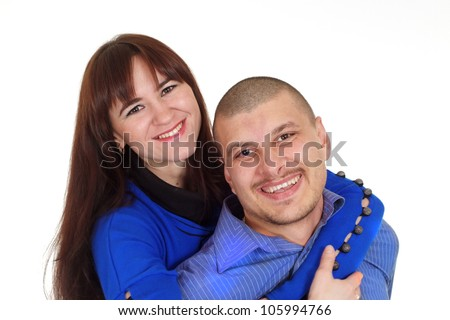 A happy adult Caucasian couple standing arm in arm on a white background
