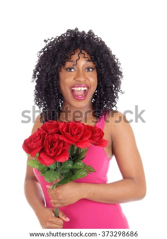 A happy African American woman on valentines day with a bunch of redroses, in a pink dress, isolated for white background. - stock photo