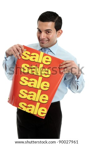 A happy and friendly smiling retail salesman holding a sale sign banner.  White background. - stock photo