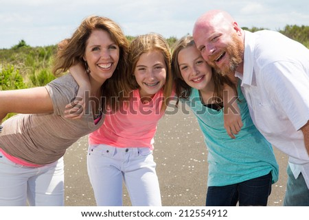A happy and healthy family huddle together  - stock photo