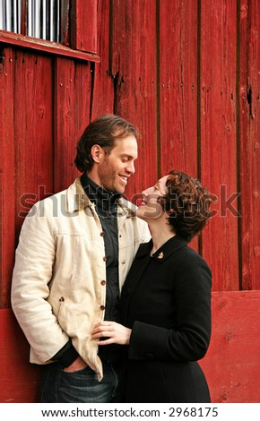 a happy and playful couple - stock photo