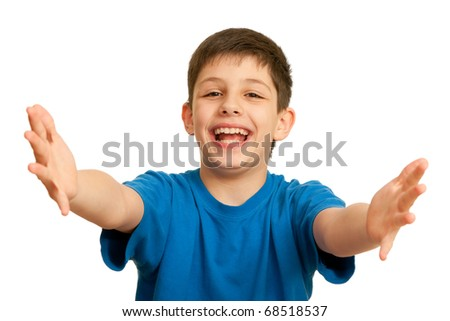 A happy boy is welcoming an invisible guest; isolated on the white background - stock photo