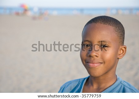 a happy boy on a sunny day at the beach - stock photo