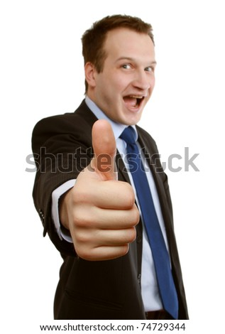 A happy businessman showing ok, focus on the hand - stock photo