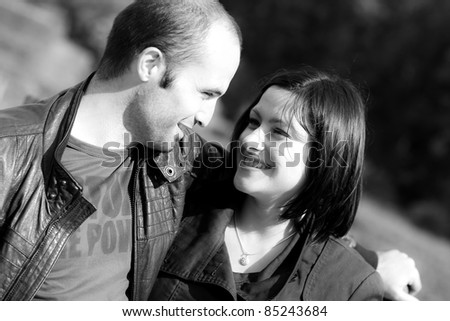 A happy couple are smiling together - stock photo