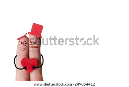 A happy couple in love , with red heart in hand. - stock photo