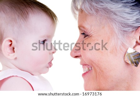 A happy family bonding together. A grandmother and Grandaugher - stock photo