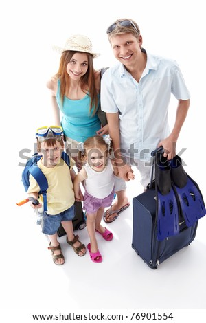 A happy family going on holiday on a white background - stock photo