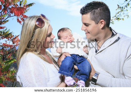 A Happy family having fun outdoors in autumn - stock photo