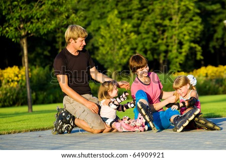A happy family in roller skates