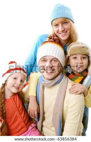 A happy family in winter clothing over white background
