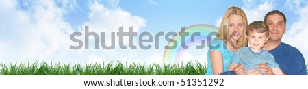 A happy family portrait is against a nature outdoor background with clouds and grass. Use as a header and add your text to the copyspace. - stock photo