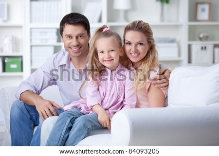 A happy family with a child at home - stock photo