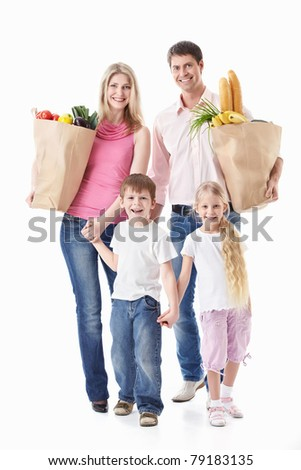 A happy family with their purchases on a white background