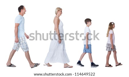 A Happy Family With Two Children Walking In A Line Isolated On White Background