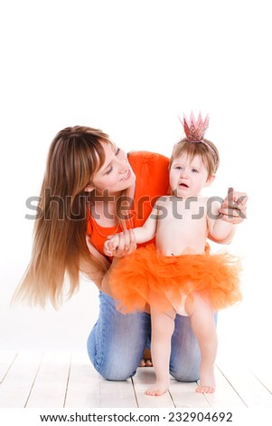 A happy family. young mother with baby girl. happy mother with baby isolated on white background. studio portrait - stock photo