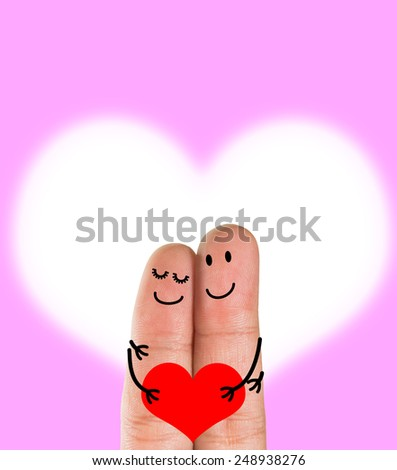 A happy finger couple in love  with painted smiley holding red heart, pink Heart background ,Valentine's Day - stock photo