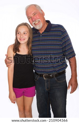 A happy Grandfather poses for a photo with his beautiful granddaughter - stock photo