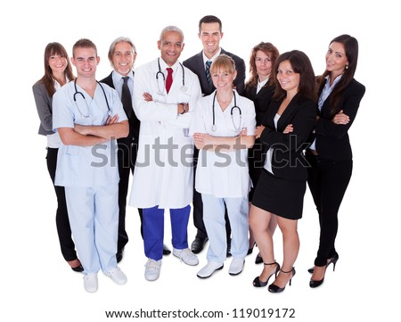 A happy group photo depicting a group of staff people. Isolated on white - stock photo